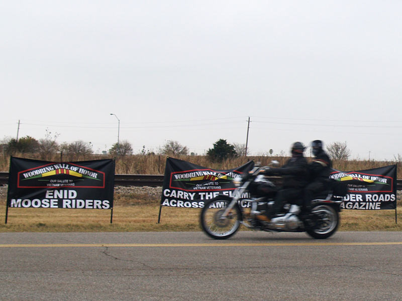 Bike in front of Moose, Flame, ThunderRoads banners